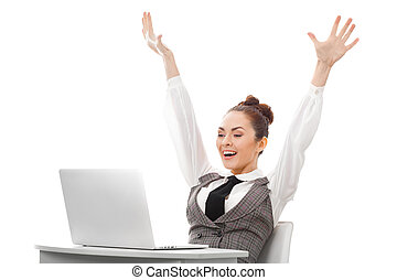 Happy Computer User - Young business woman sitting at table...