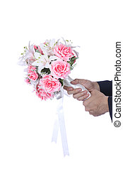 Business man holding a bouquet of pink roses