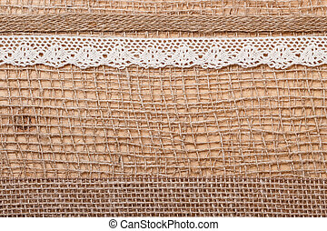 Lace ribbon on burlap cloth background - Lace and jute...