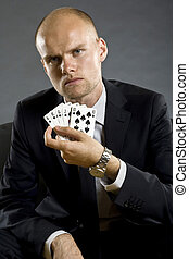 Poker player showing best hand