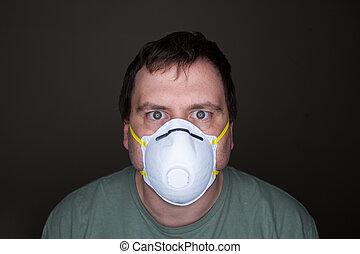 man staring at the camera wearing his mask