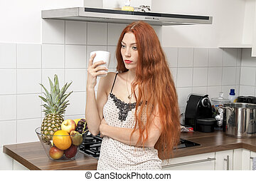 Serious Blond Woman Holding A Glass at the Kitchen - Serious...