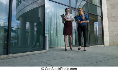 Businesswoman going out business center - Going to the...