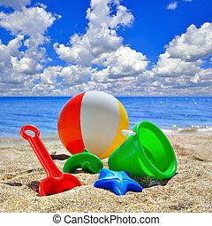 Baby Toys on beach sand
