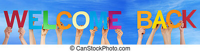 People Hands Holding Colorful Straight Word Welcome Back...