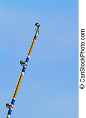 Fishing Pole and Line - A fishing pole with fishing line is...