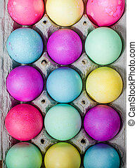Egg carton of colorful dyed Easter eggs - Paper egg carton...