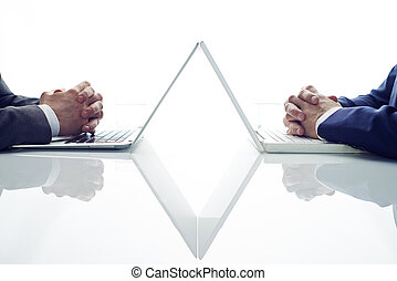 Business decision - Two businessmen with joining fingers...