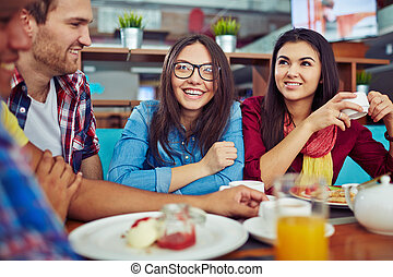 Dinner and chatting - Pretty student having dinner and...