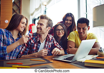 Five friends - Five students looking at laptop