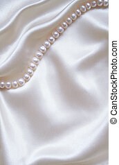 Smooth elegant white silk with pearls as wedding background...