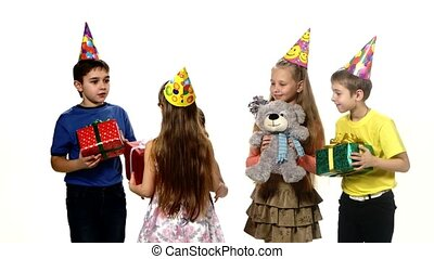 Happy birthday girl gets gifts from their friends. There are so many that it can not keep them