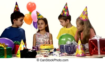 ?ompany children waiting until girlfriend make a wish and blow out the candles