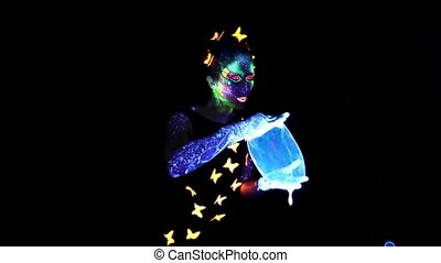 Woman with luminous make up making group bubbles - Video of...