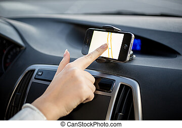 driver using  touchscreen smartphone with GPS navigation
