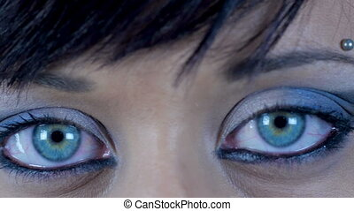 close up of blue green female eyes - close up of blue woman...