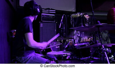 Drummer with headphones - Drummer play on drum set
