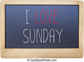 I love Sunday on Blank blackboard isolated on white...