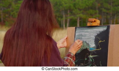 Woman With Long Brown Hair Drawing A Picture At Plein Air -...