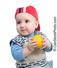 Vigorous child and fresh lemon.Rustic boy and present fresh...