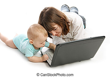 mother and baby with laptop - happy family with laptop