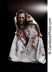crazy woman in gown with blood with knife on black...
