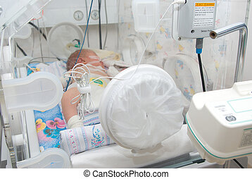 newborn baby sleeping in an incubator in hospital.branch to...