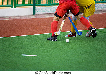 Field Hockey Action - Image of men\'s field hockey players...
