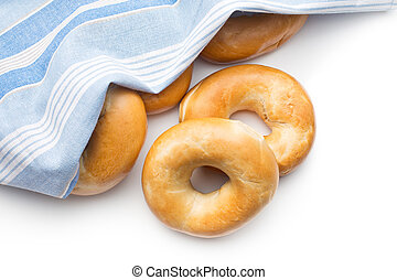 tasty bagels with napkin on white background