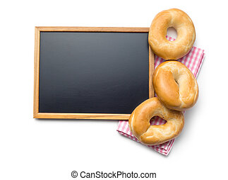 chalkboard and bagels on white background