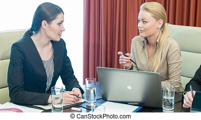 Beautiful young businesswomen at work - Colleagues at the...