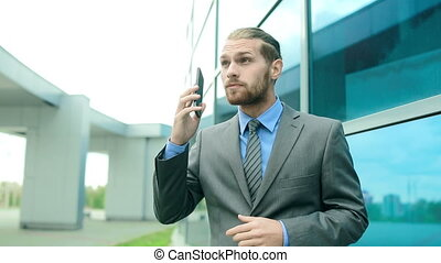Business Lifestyle - Truck down of businessman talking on...