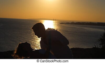 Silhouette couple kissing
