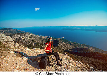 Woman traveling on the island top - Young woman photographer...