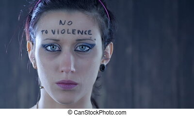 young girl abused violence - woman with written on her face...
