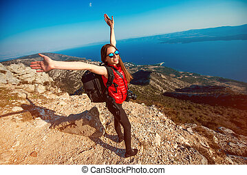 Woman traveling on the island top - Young sport woman...