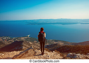 Woman traveling on the island top - Young woman traveler...