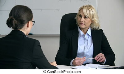 Business Briefing - Close up of bossy lady talking to...