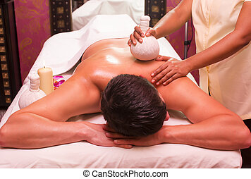 massage - people man engaged in Ayurvedic spa treatment