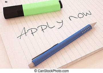 Apply now - handwritten text in a notebook on a desk - 3d...