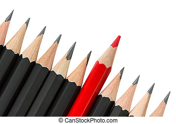 Red pencil standing out from the row of black pencils