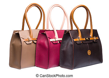 Three natural leather female purses isolated on white -...