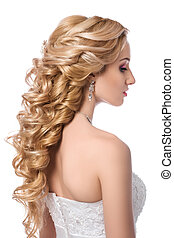 Portrait of young beautiful bride. Wedding coiffure and...