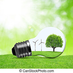 Eco bulb with wind turbines and tree Green energy concept