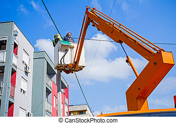 Power line team at work on a pole - Technician works in a...