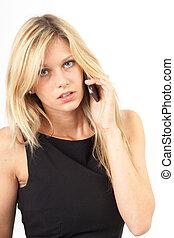 Eva neutral - Junge Frau im schwarzen Kleid telefoniert mit...