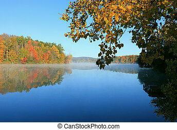 Berkshire fall foliage reflected on lake - Colorful leaves...