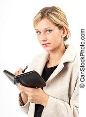 Notierende Eva - Junge Frau schaut von ihren Notizen auf in...