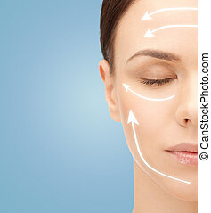 beautiful young woman face with facelift marks - beauty,...