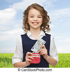 happy girl with purse and paper money - finances, childhood,...